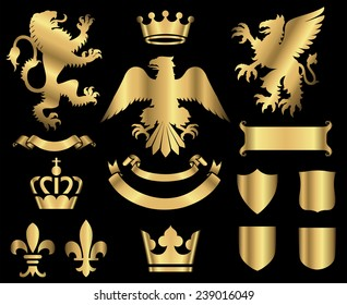 Gold Heraldry Ornaments - Gold heraldry ornaments isolated on a black background.  All elements are grouped separately for easy editing.