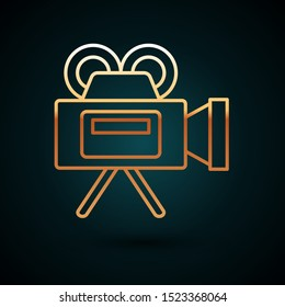 Gold line Cinema camera icon isolated on dark blue background. Video camera. Movie sign. Film projector.  Vector Illustration