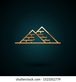 Gold line Egypt pyramids icon isolated on dark blue background. Symbol of ancient Egypt.  Vector Illustration