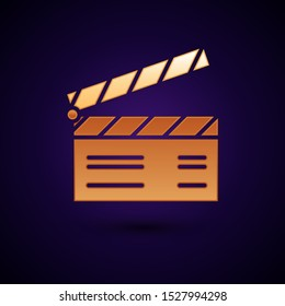 Gold Movie clapper icon isolated on dark blue background. Film clapper board. Clapperboard sign. Cinema production or media industry concept.  Vector Illustration