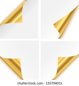 Gold Paper Corner Folds - Set of four gold paper corner folds isolated on white background.
