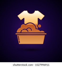 Gold Plastic basin with soap suds icon isolated on dark blue background. Bowl with water. Washing clothes, cleaning equipment.  Vector Illustration