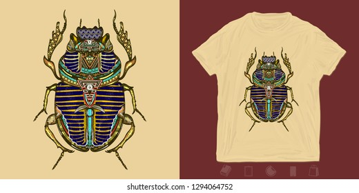 Gold scarab. Print for t-shirts and another, trendy apparel design. Egyptian sacred bug gold scarab, symbol of sun