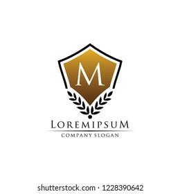 Gold Shield M Letter Logo