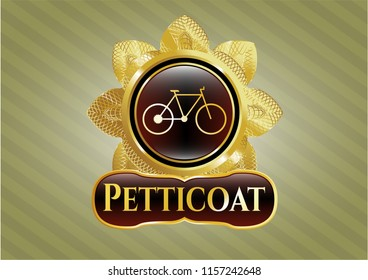 Gold shiny badge with bike icon and Petticoat text inside