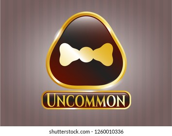 Gold shiny badge with bow tie icon and Uncommon text inside