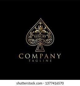 Gold Spade Luxury Logo vector / The heart ace gold stock vector
