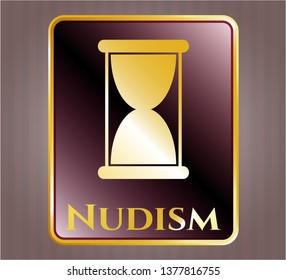 Golden badge with hourglass icon and Nudism text inside