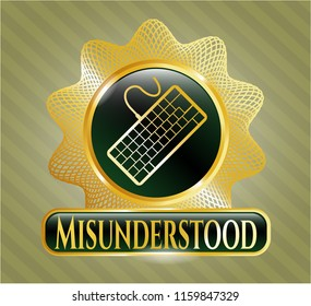 Golden badge with keyboard icon and Misunderstood text inside
