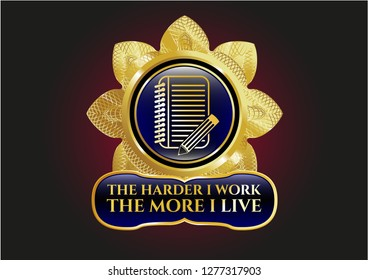 Golden badge with notebook with pencil icon and The Hardest I work the More I Live text inside