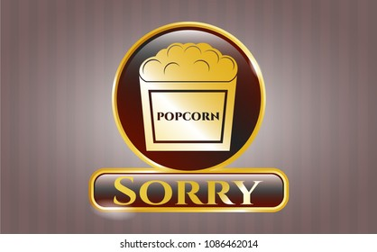 Golden badge with popcorn icon and Sorry text inside