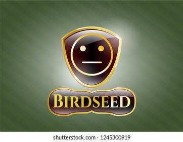 Golden badge with serious face icon and Birdseed text inside