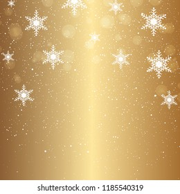 Golden Christmas background of falling snowflakes