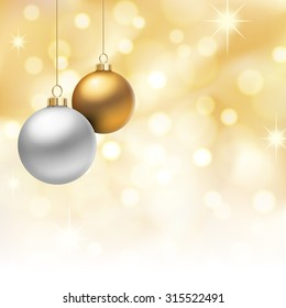 A Golden Christmas background, with gold and silver christmas balls hanging from above.