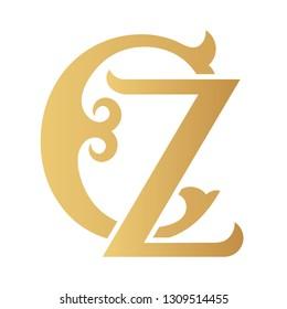 Golden CZ monogram isolated in white.