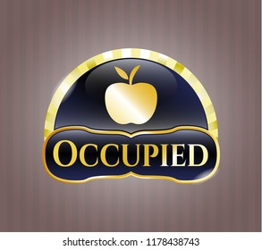 Golden emblem or badge with apple icon and Occupied text inside