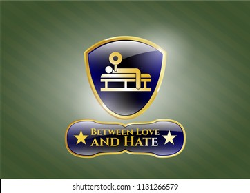 Golden emblem or badge with bench press icon and Between Love and Hate text inside