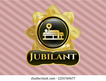 Golden emblem or badge with bench press icon and Jubilant text inside