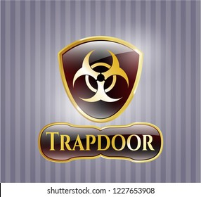 Golden emblem or badge with biohazard icon and Trapdoor text inside