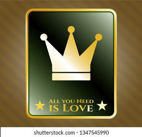 Golden emblem with crown icon and All you Need is Love text inside