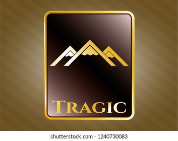 Golden emblem with mountain icon and Tragic text inside