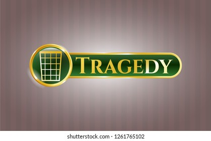 Golden emblem with wastepaper basket icon and Tragedy text inside