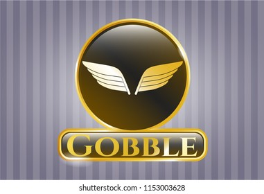 Golden emblem with wings icon and Gobble text inside