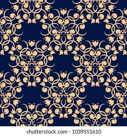 Golden floral design on dark blue background. Seamless pattern for textile and wallpapers