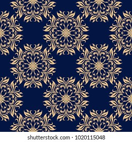 Golden floral ornament on dark blue background. Seamless pattern for textile and wallpapers