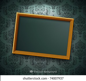 Golden frame on the wall. Vintage background
