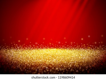 Golden glitter retro background with abstract shiny light rays in the darkness of red backdrop
