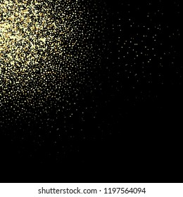Golden glitter texture on a black background Golden explosion of confetti.
