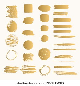 Golden ink shapes with rough edges. Glitter paint stroke.