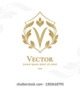 Golden leaf emblem. Elegant, classic vector. Can be used for jewelry, beauty and fashion industry. Great for logo, monogram, invitation, flyer, menu, brochure, background, or any desired idea.
