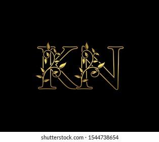 Golden  letter K, N and KN  Vintage Gold Floral Logo Icon, overlapping monogram logo, elegant luxury gold color on black background. CLassy Letter Logo Icon.