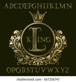 Golden patterned letters and initial monogram in coat of arms form with crown. Royal font and elements kit for logo design.