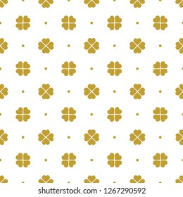Golden quatrefoil seamless pattern background in white color. Vintage and retro abstract ornamental design. Perfect for wrapping paper or fabric.