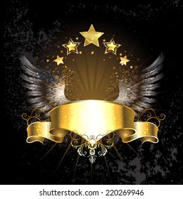 Golden ribbon decoration angel wings and gold stars on black background.