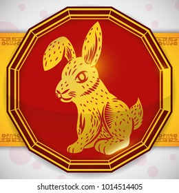 Golden silhouette of a rabbit over red button in traditional twelve-sided shape for Chinese Zodiac.