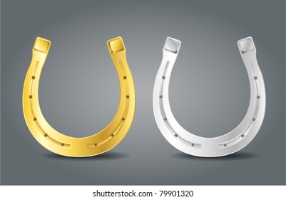 Golden and silver horseshoes. Symbol of luck