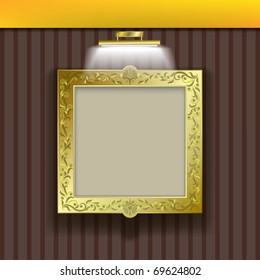 golden square frame with spotlight on brown wallpaper