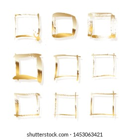 Golden square frames made of brush stroke isolated on white background. Vector design elements set