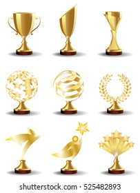 Golden Trophy Cups and Awards  in the form of  abstract shapes with the stars and lines, Laurel wreath, bird and Superman. Realistic vector set, illustration isolated on white background.