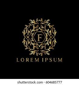 Golden vector monogram Letter F logo design template with floral ornaments