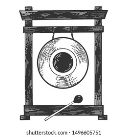 Gong musical percussion instrument circular metal disc sketch engraving vector illustration. Tee shirt apparel print design. Scratch board style imitation. Black and white hand drawn image.