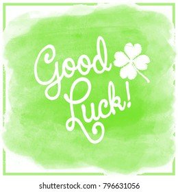 Good Luck! Lettering with a four-leaf clover on light green watercolor background with a simple square frame. Vector.