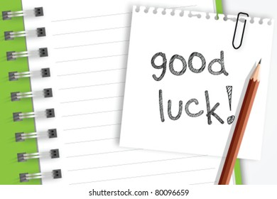 Good luck word on note paper
