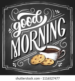 Good morning hand drawn lettering on black chalkboard background, with sketch cup of coffee and cookies illustration. Vintage vector design.