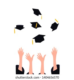 Graduates throwing graduation hats with tassel in the air. University ceremony concept.