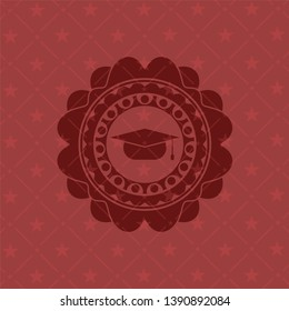 graduation cap icon inside badge with red background